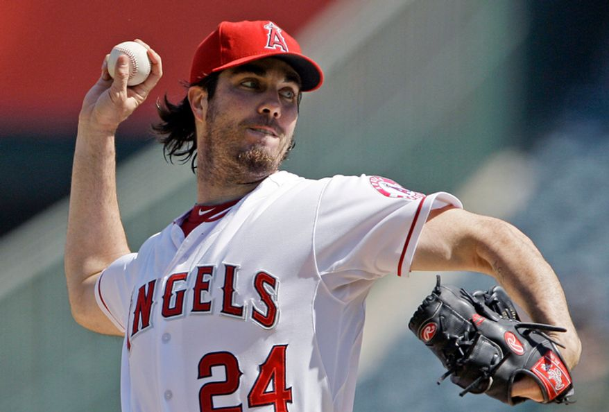 In this Sept. 27, 2012, file photo, Los Angeles Angels starter Dan Haren pitches to the Seattle Mariners in the second inning of a baseball game in Anaheim, Calif. A person familiar with the talks tells The Associated Press on Tuesday, Dec. 4, 2012, that the free agent pitcher and the Washington Nationals are close to completing a one-year deal for $13 million. (AP Photo/Reed Saxon, File)