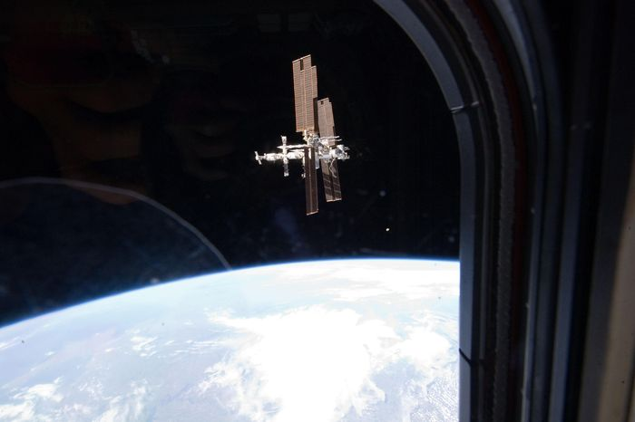 **FILE** This image from July 19, 2011, provided by NASA, shows the International Space Station photographed by a member of Atlantis' STS-135 crew during a fly-around as the shuttle departed the station on the last space shuttle mission. (Associated Press/NASA)