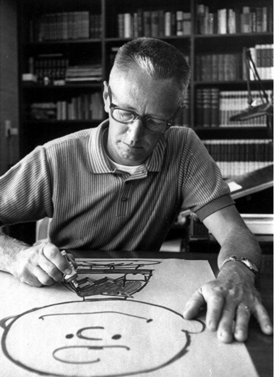 "Cartoonist Charles M. Schulz draws a picture of his cartoon character Charlie Brown in his Sebastopol, Calif., home in a 1966 photo. Before ""Peanuts,"" Schulz taught art with two men named Charles Brown and Linus Maurer. He dated a little red-haired girl who crushed his heart. He felt loss, isolation and a burning passion to be a cartoonist. (AP Photo"