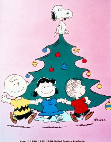 """With Snoopy atop the tree, Charlie Brown, Lucy and Linus celebrate the holiday season in """"A Charlie Brown Christmas."""" The animated classic was written by """"Peanuts"""" creator Charles M. Schulz with a musical score by Vincent Anthony """"Vince"""" Guaraldi. (AP Photo/United Feature Syndicate Inc.)"""