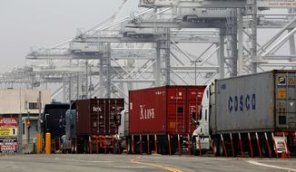 Trucks wait in long lines to load at the Port of Long Beach, Calif., on Tuesday, Dec. 4, 2012. (AP Photo/Nick Ut)