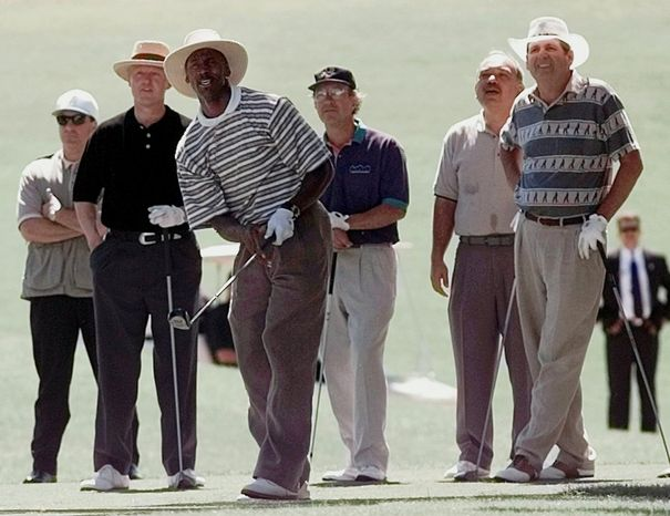 ** FILE ** President Clinton (left) watches as the Chicago Bulls' Michael Jordan tees off at the Las Vegas Country Club in Las Vegas on Monday, July 28, 1997. From left are an unidentified Secret Service agent, Mr. Clinton, Mr. Jordan, Brian Greenspun, former Hawaii Gov. John Waihee and Nevada Gov. Bob Miller. (AP Photo/Ruth Fremson)