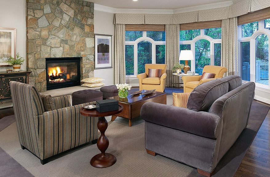 The Winthrop features an octagonal family room with a fireplace and walls of windows.