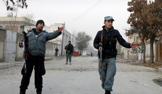 Policemen stand guard near the scene where Afghan intelligence chief Asadullah Khalid was wounded in an assassination attempt in Kabul, Afghanistan, on Thursday, Dec. 6, 2012. (AP Photo/Ahmad Jamshid)