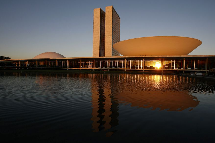 Brazil's National Congress building in Brasilia, the nation's capital, was designed by architect Oscar Niemeyer and inaugurated in 1960. (AP Photo/Eraldo Peres)