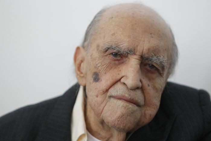 Brazilian architect Oscar Niemeyer attends a 2010 ceremony in Rio de Janeiro at which he was decorated with Spain's Arts and Letters medal. (AP Photo/Felipe Dana)
