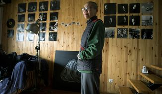Liu Xia, wife of 2010 Nobel Peace Prize winner Liu Xiaobo, stands Dec. 6, 2012, in her Beijing home where she has been held under house arrest for more than two years. Liu trembled uncontrollably and cried as she described how her confinement under house arrest has been absurd and emotionally draining in the two years since her jailed activist husband was named a Nobel Peace laureate. (Associated Press)