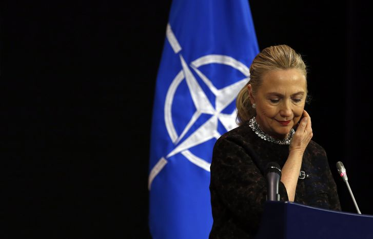 Secretary of State Hillary Rodham Clinton pauses during a news conference at NATO headquarters in Brussels on Wednesday, Dec. 5, 2012. (AP Photo/Kevin Lamarque, Pool)