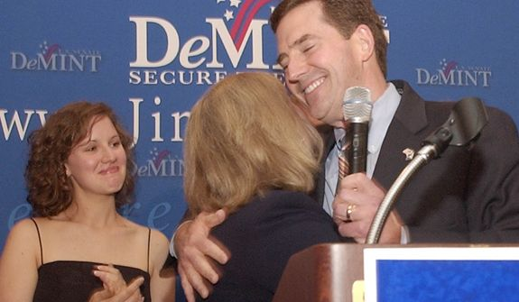 Rep. Jim DeMint hugs his wife, Debbie, as their daughter Donna looks on after Mr. DeMint won the U.S. Senate Republican primary runoff by defeating former Gov. David Beasley on Tuesday, June 22, 2004, in Columbia, S.C. (AP Photo/Mary Ann Chastain)
