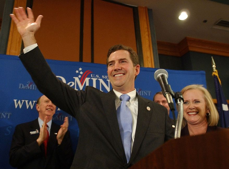 U.S. Senator-elect Jim DeMint, South Carolina Republican, takes the stage with his wife, Debbie, on Tuesday, Nov. 2, 2004, at the Adams Mark Hotel in Columbia, S.C. Mr. DeMint defeated Democrat Inez Tenebaum. (AP Photo/Mary Ann Chastain)