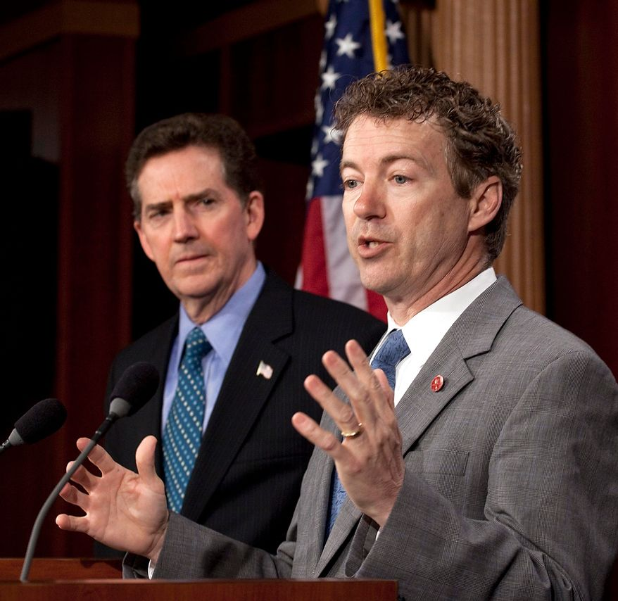 Sen. Rand Paul, Kentucky Republican, speaks at a news conference on the budget on Capitol Hill in Washington on Thursday, March 17, 2011, as Sen. Jim DeMint, South Carolina Republican, listens. (AP Photo/Harry Hamburg)