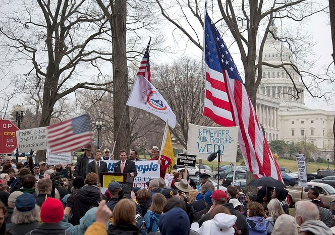 Sen. Jim DeMint (at the podium), accompanied by Sen. Rand Paul, addresses a tea party Continuing Revolution Rally on Thursday, March 31, 2011, on Capitol Hill in Washington. (AP Photo/Evan Vucci)