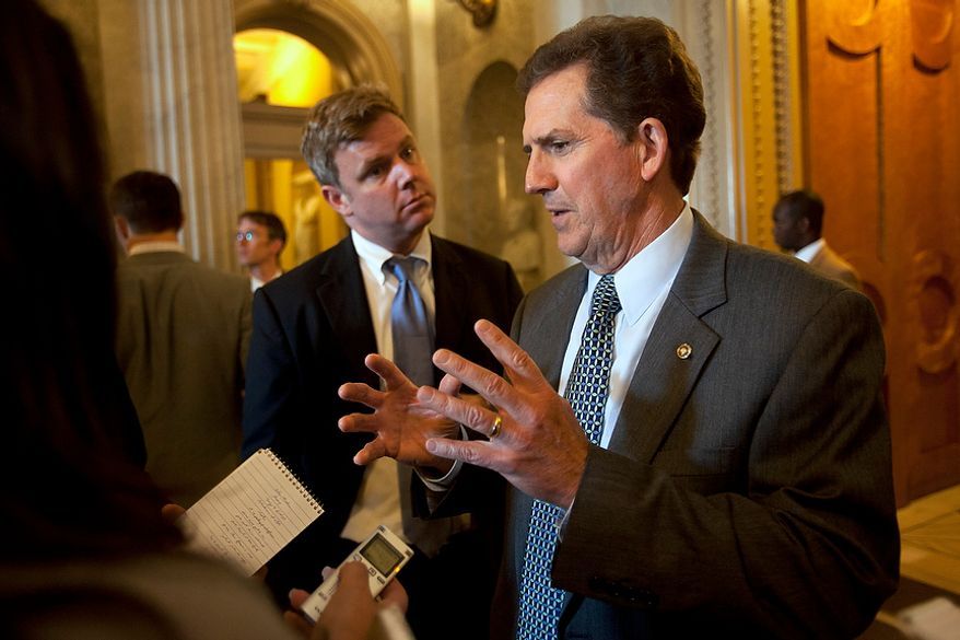 Sen. Jim DeMint, South Carolina Republican, is interviewed on Capitol Hill in Washington on Thursday, July 12, 2012. (AP Photo/Jacquelyn Martin)