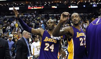 Los Angeles Lakers shooting guard Kobe Bryant (24) high fives teammates with center Jordan Hill (27) after an NBA basketball game between the New Orleans Hornets and the Los Angeles Lakers in New Orleans, Wednesday, Dec. 5, 2012. The Lakers won 103-87. (AP Photo/Gerald Herbert)