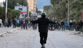 **FILE** Tunisian protesters clash with riot police in Siliana, Tunisia, on Dec. 1, 2012. (Associated Press)