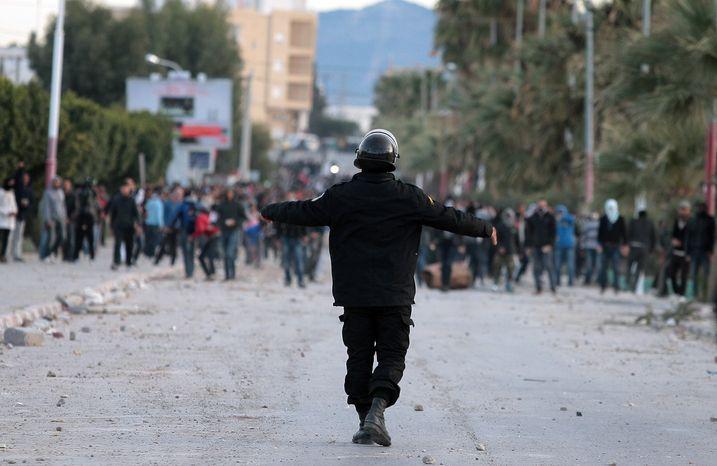 **FILE** Tunisian protesters clash with riot police in Siliana, Tunisia, on Dec. 1, 2012. (Associated Press)
