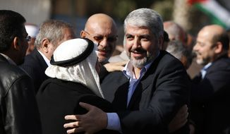 Exiled Hamas chief Khaled Mashaal arrivaes at Rafah crossing in the southern Gaza Strip on Dec. 7, 2012. The exiled chief broke into tears as he arrived in the Gaza Strip for his first-ever visit, a landmark trip reflecting his militant group's growing international acceptance and its defiance of Israel. (Associated Press)