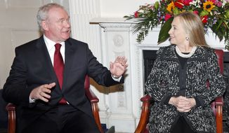 U.S. Secretary of State Hillary Rodham Clinton meets with Northern Ireland Deputy First Minister Martin McGuinness at Stormont Castle in Belfast on Dec. 7, 2012. Clinton traveled to Northern Ireland to lend her support to the British province's fragile peace, the frailty of which was underlined by overnight rioting on the eve of her visit and the seizure of a bomb. (Associated Press)