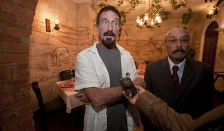 "**FILE** Software company founder John McAfee (left) accompanied by his lawyer, Telesforo Guerra, answers questions during an interview at a local restaurant in Guatemala City on Dec. 4, 2012. McAfee, 67, has been identified as a ""person of interest"" in the killing of his neighbor in Belize, 52-year-old Gregory Faull. The anti-virus company founder fled Belize and is seeking political asylum in Guatemala, according to his lawyer. (Associated Press)"