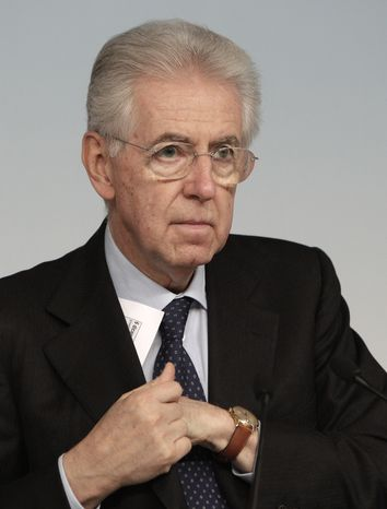 Italian Premier Mario Monti listens to a question during a press conference at the end of a cabinet meeting at Chigi Palace government's office in Rome on Dec. 6, 2012. (Associated Press)