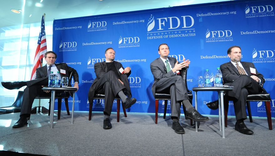 "Bret Stephens, deputy editor of the Wall Street Journal; Reuel Marc Gerecht, senior fellow at Foundation for Defense of Democracies (FDD); Brian Katulis, senior fellow at the Center for American Progress; and Rob Satloff, executive director of Washington Institute for Near East Policy, sit on a panel titled ""Islamists and Elections: Where Do They Lead?"" at FDD's annual national security conference on Dec. 6, 2012. (Lloyd Wolf/FDD)"
