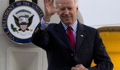 **FILE** Vice President Joseph R. Biden Jr. waves as he arrives to Benito Juarez International airport in Mexico City on Nov. 30, 2012. (Associated Press)