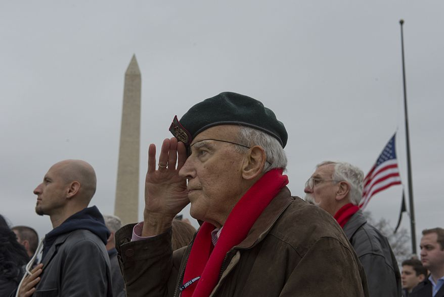 Eighty-eight-year-old Thomos Conlon of Cumberland, Md. stands at attention and salutes during the playing of the national anthem at the National Pearl Harbor Remembrance Day celebration at the National World War II Memorial in Washington, D.C. on Friday, Dec. 7, 2012. Mr. Conlon fought in the Pacific with the U.S. Army and was one of the soldiers who lined the tracks during Pres. Roosevelt's funeral train parade. (Barbara L. Salisbury/The Washington Times)