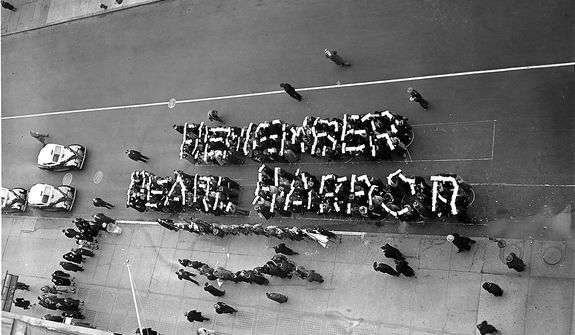 "Members of the Hearns Volunteer National Defense Corps spell the slogan ""Remember Pearl Harbor"" at a rally held on 14th St. between Fifth and Sixth Avenues in New York City, Dec. 27, 1941.  (AP Photo)"