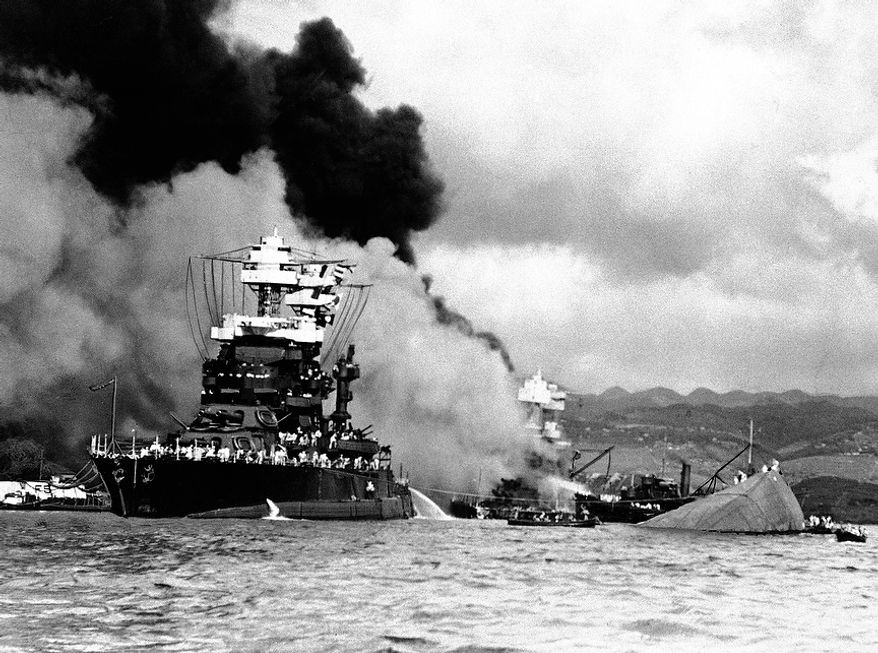 In this image provided by the U.S. Navy, U.S.S. Nevada beached at Hospital Point at Pearl Harbor, Hawaii in December 1941. (AP Photo/U.S. Navy)
