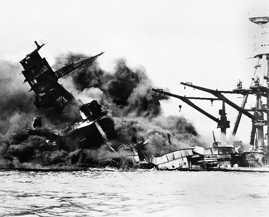 "The battleship USS Arizona belches smoke as it topples over into the sea during Japanese surprise attack on Pearl Harbor, Hawaii, December 7, 1941. The ship sank with more than 80 percent of its 1,500-man crew, including Rear Admiral Issac C. Kidd. The attack, which left 2,343 Americans dead and 916 missing, broke the backbone of the U.S. Pacific Fleet and forced America out of a policy of isolationism. President Franklin D. Roosvelt announced that it was ""a date which will live in infamy"" and Congress declared war on Japan the morning after. This was the first attack on American territory since 1812. (AP Photo)"