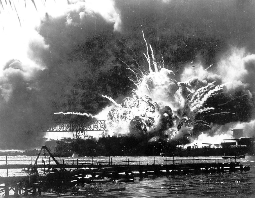 In this Dec. 7, 1941 file photo, the destroyer USS Shaw explodes after being hit by bombs during the Japanese surprise attack on Pearl Harbor, Hawaii. Wednesday marks the 70th anniversary of the attack that brought the United States into World War II. (AP File Photo)