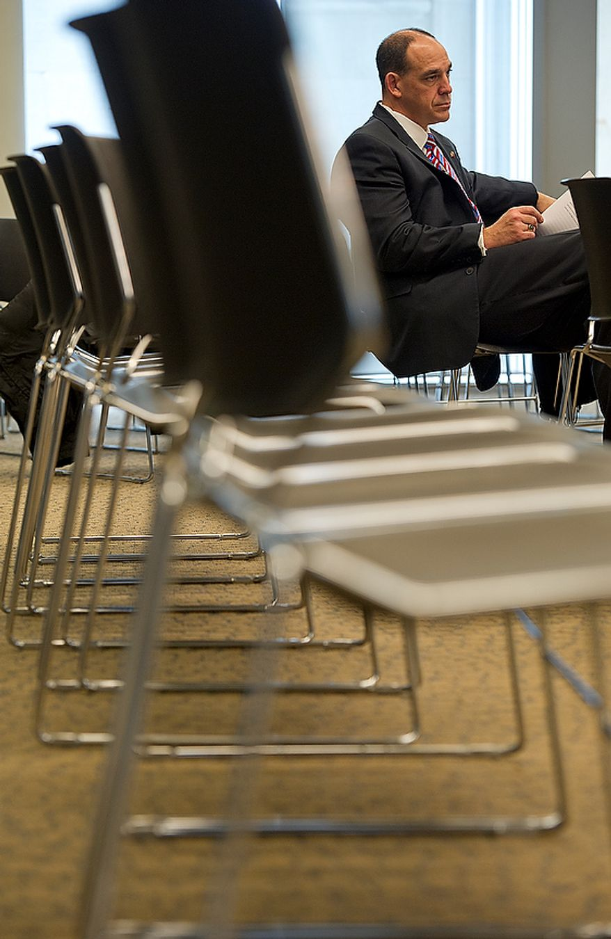 Christopher Geldart, director of the Homeland and Emergency Management Agency, waits to testify at a public oversight roundtable on the Emergency Preparedness for the 2013 Presidential Inauguration, held by D.C. Councilman Phil Mendelson Thursday, De. 6, 2012 at the Wilson Building in Washington, D.C. Geldart told the councilman that they have learned many lessons from the 2009 inauguration and are planning accordingly. He also said that they do not expect the record crowds this time that they had then. (Barbara L. Salisbury/The Washington Times)