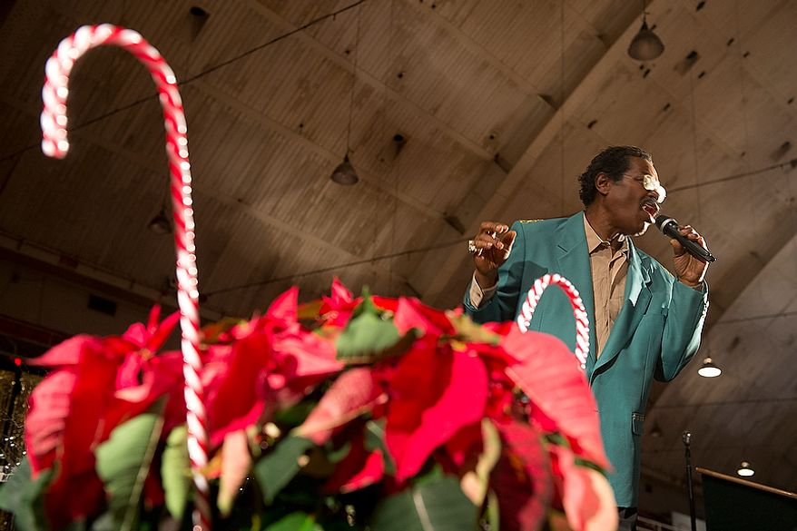 Frank Washington, former singer for The Spinners, performs at the District's annual Senior Holiday Celebration at the D.C. Armory in Washington, D.C. on Wednesday, Dec. 5, 2012. The event included all kinds of musical entertainment. (Barbara L. Salisbury/The Washington Times)