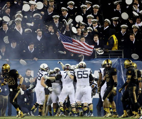 Navy players celebrate after a touchdown by quarterback Keenan Reynolds during the second half of an NCAA college football game against Army, Saturday, Dec. 8, 2012, in Philadelphia. Navy won 17-13. (AP Photo/Matt Slocum)