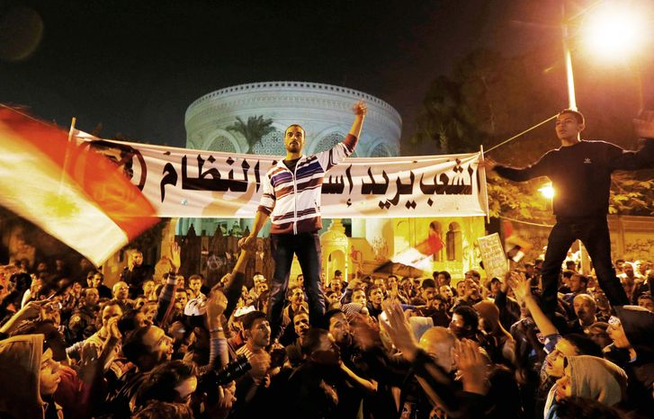 Hostility: Opposition activists rally Sunday in front of the presidential palace in Cairo and intend to keep up the momentum of its street campaign. Supporters of President Mohammed Morsi plan demonstrations at the same time. (Associated Press)