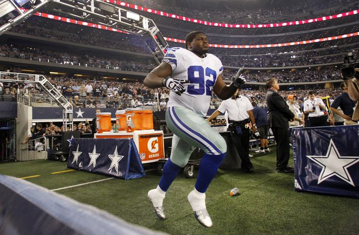Dallas Cowboys nose tackle Josh Brent runs onto the field from the team's tunnel after being introduced before an NFL football game against the Philadelphia Eagles in Arlington, Texas, on Sunday, Dec. 2, 2012. (AP Photo/Tony Gutierrez)