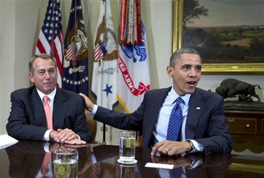 "** FILE ** In this Nov. 16, 2012, photo, President Obama acknowledges House Speaker John Boehner of Ohio while speaking to reporters in the Roosevelt Room of the White House in Washington. Admnistration officials say Mr. Obama and Mr. Boehner met Sunday, Dec. 9, 2012, at the White House to discuss the ongoing negotiations over the impeding ""fiscal cliff."" (AP Photo/Carolyn Kaster, File)"