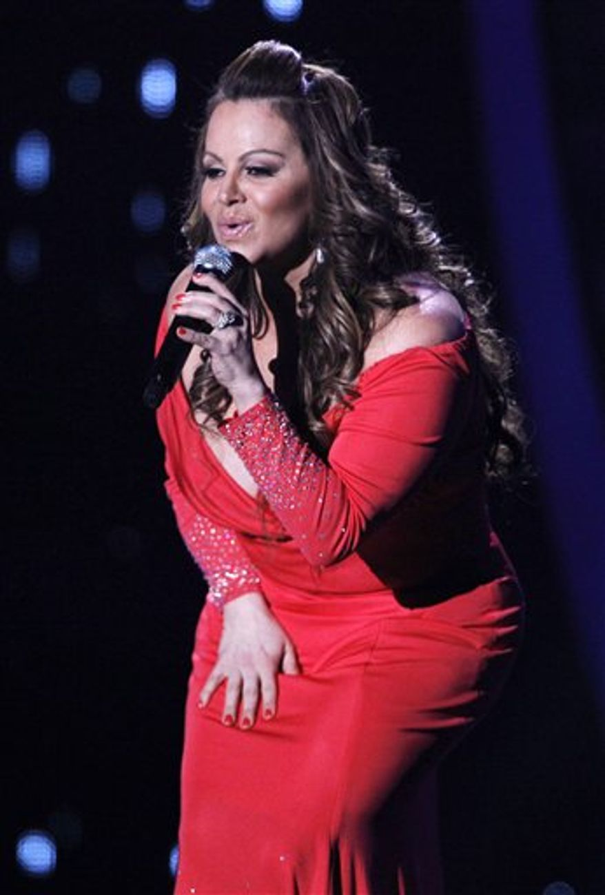 ** FILE ** In this April 26, 2012, photo, singing superstar Jenni Rivera performs during the Latin Billboard Awards in Coral Gables, Fla. Authorities in Mexico say the wreckage of a small plane believed to be carrying Rivera has been found on Sunday, Dec. 9, 2012, and there are no apparent survivors. (AP Photo/Lynne Sladky)