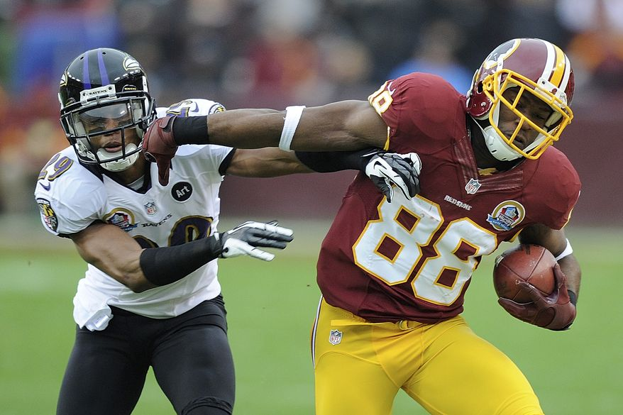 Washington Redskins wide receiver Pierre Garcon, right, pushes Baltimore Ravens cornerback Cary Williams away during the first half of an NFL football game in Landover, Md., Sunday, Dec. 9, 2012. (AP Photo/Nick Wass)