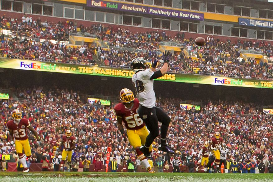 Baltimore Ravens tight end Dennis Pitta (88) catches a 14 yard touchdown pass in the second quarter as the Washington Redskins play the Baltimore Ravens at Fedex Field, Landover, Md., Sunday, December 9, 2012. (Andrew Harnik/The Washington Times)