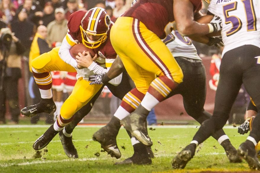 Washington Redskins quarterback Kirk Cousins (12) runs the ball in for a two point conversion to send the game into overtime as the Washington Redskins play the Baltimore Ravens at Fedex Field, Landover, Md., Sunday, December 9, 2012. (Andrew Harnik/The Washington Times)