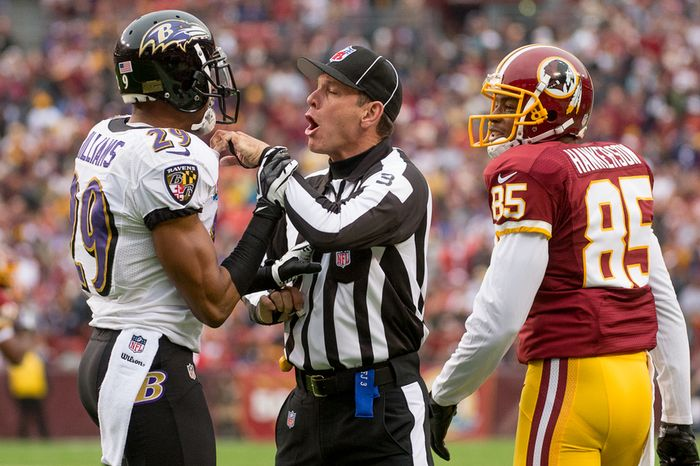 A referee breaks up Baltimore Ravens cornerback Cary Williams (29) and Washington Redskins wide receiver Leonard Hankerson (85) after a play in the first quarter as the Washington Redskins play the Baltimore Ravens at Fedex Field, Landover, Md., Sunday, December 9, 2012. (Andrew Harnik/The Washington Times)
