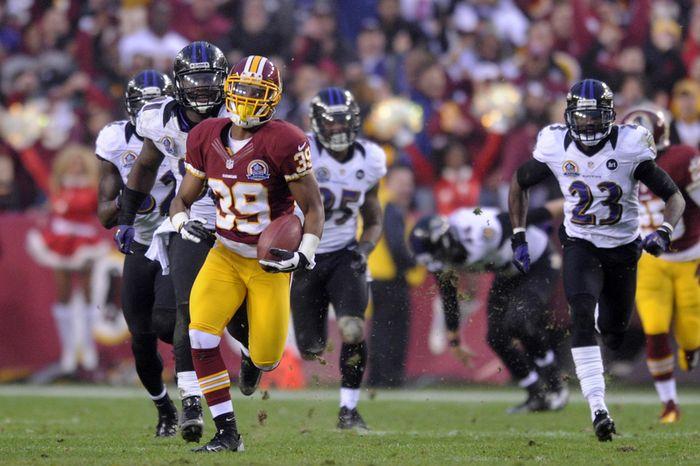 Washington Redskins cornerback Richard Crawford (39) returns an overtime punt 64 yards to the Baltimore 24 yard line at FedEx Field, Landover, Md., Dec. 9, 2012. (Preston Keres/Special to The Washington Times)