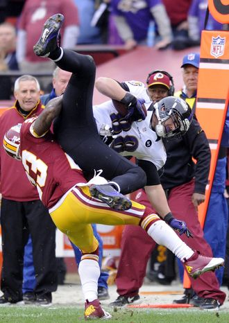 Washington Redskins cornerback DeAngelo Hall (23) stops Baltimore Ravens tight end Dennis Pitta (88) shy of the first down in the first quarter at FedEx Field, Landover, Md., Dec. 9, 2012. (Preston Keres/Special to The Washington Times)