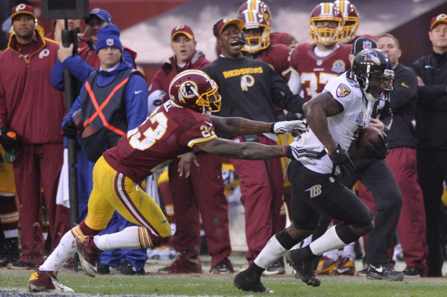 Baltimore Ravens wide receiver Anquan Boldin (81) breaks from Washington Redskins cornerback DeAngelo Hall (23) and runs to the 7 yard line setting up a fourth quarter touchdown at FedEx Field, Landover, Md., Dec. 9, 2012. (Preston Keres/Special to The Washington Times)