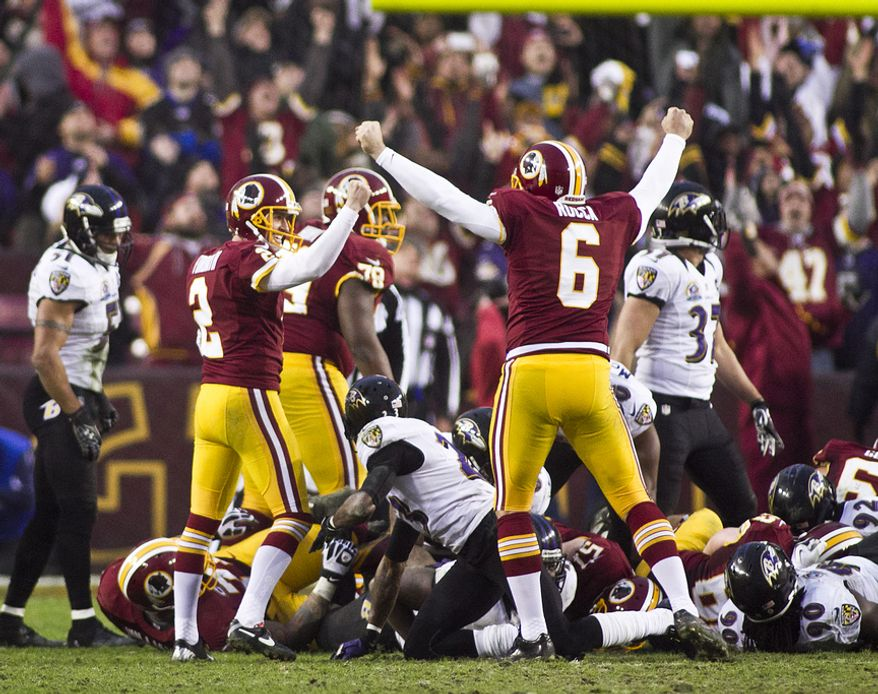 Washington Redskins kicker Kai Forbath (2) hits a game winning 34 yard field goal in overtime against the Baltimore Ravens at FedEx Field in Landover Md., on Sunday, December 9, 2012. Washington Redskins won 31 to 28. (Craig Bisacre/The Washington Times)