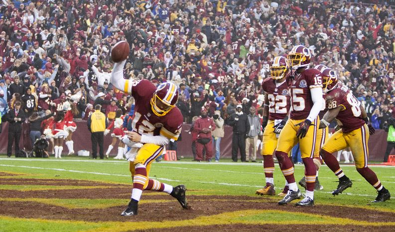 Washington Redskins quarterback Kirk Cousins (12) celebrates after runs in the 2 point conversion to tie the game against the Baltimore Ravens at FedEx Field in Landover Md., on Sunday, December 9, 2012. Washington Redskins won 31 to 28. (Craig Bisacre/The Washington Times)
