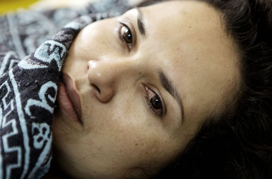 Lucia Aguero lies in a hospital last month on the 50th day of her 59-day hunger strike in Coronel Oviedo, Paraguay. Shot in the thigh in June during a ranch occupation that turned deadly, she ultimately removed the bullet herself with a razor blade and then was jailed for her participation in the protest. (Associated Press)