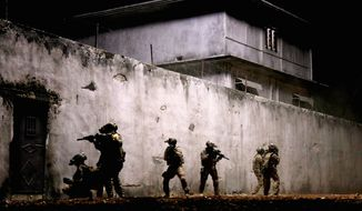 """Navy SEALs raid Osama Bin Laden's compound in """"Zero Dark Thirty,"""" directed by Kathryn Bigelow. The film is among the American Film Institute's Top 10 movies of the year announced Monday. (Columbia Pictures Industries via Associated Press)"""
