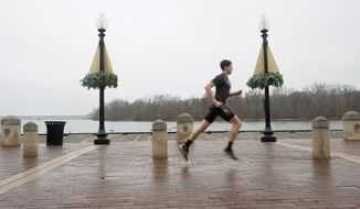 Short sleeves and shorts were just fine attire for a jogger along the Georgetown waterfront on Monday, another abnormally warm day in the District this year. With just three weeks to go, it looks like 2012 could be the warmest year ever in the U.S. (Barbara L. Salisbury/The Washington Times)